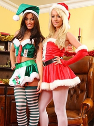 Natalia and Alana tease each other out of their Kinky Christmas outfits pictures at lingerie-mania.com