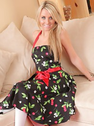 Pretty blonde looks amazing in her summer dress and candy stripe heels pictures at kilogirls.com