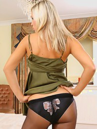 Jenni P is a real stunner in her green top and black miniskirt with pantyhose pictures at lingerie-mania.com