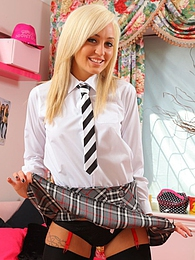 Paige D looks sexy in her cute red college uniform with stockings and heels pictures at freekilosex.com