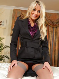 Stunning secretary wearing a black skirt suit and satin blouse pictures at find-best-lingerie.com