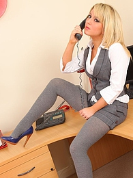 Gorgeous secretary teases her way out of the sexy suit pictures