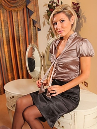Nicole rushes home after a long hard day in the office and teases her way out of her tight silk blouse and black pencil skirt pictures at freelingerie.us