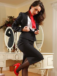 Gorgeous dark haired air hostess teases in her tight skirt suit before stripping down to her panties stockings and heels pictures at find-best-lesbians.com