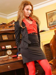 Faye shows off her seductive side as she strips out of her skirt suit and red stockings pictures at kilosex.com
