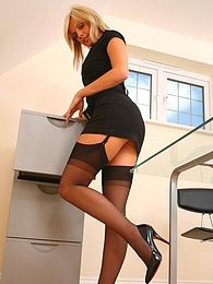Delightful secretary slips out of the tight minidress and shows off sexy underwear pictures
