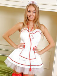 Sexy nurse wearing fancy red stockings pictures at freekiloclips.com
