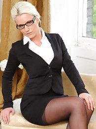 Busty Billie in her office uniform pictures at kilosex.com