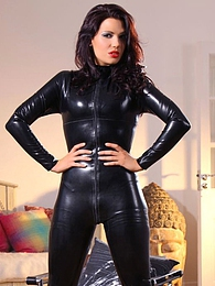 Kinky brunette unzips her tight black catsuit to reveal her hot body in lemon lingerie pictures at find-best-panties.com