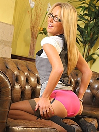 Becky R strips from office suit & pink suspenders pictures at lingerie-mania.com