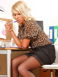 Gorgeous blonde looks sensational in her leopard print blouse black skirt and matching high heels pictures at lingerie-mania.com
