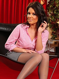 Kelly M in a pink shirt and grey miniskirt pictures at find-best-babes.com
