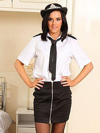 Abbie strips from a sexy police womans outfit pictures at kilosex.com