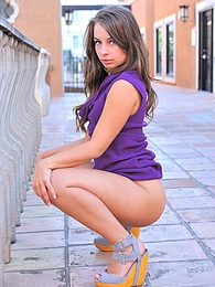 Sofia outside doing upskirts pictures at lingerie-mania.com