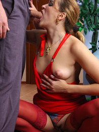 Lusty milf in a red gown flirting with a guy for a fuck with oral foreplay pictures at find-best-lingerie.com