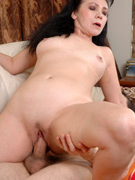 Salacious mature begging her younger lover for a steamy romp on the sofa pictures at sgirls.net