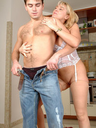 Dazzling blond milf getting spread by a boy for wet 69ing and hard screwing pictures at lingerie-mania.com