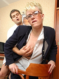 Hot mature business woman bending over in hot quickie with young co-worker pictures at freekilomovies.com