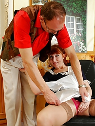 Red-haired maid bending down giving extra service to her lustful old master pictures at freekilomovies.com
