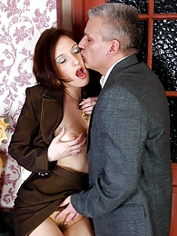 Pretty office girl getting quick promotion onto her graying boss's pecker pictures at adspics.com