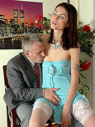 Lean girl having her old boss peep under her skirt and get into her panties pictures at freekilomovies.com