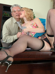 Slutty young secretary luring her graying boss into hot quickie on the desk pictures