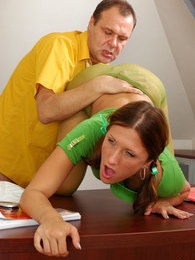 Pigtailed bimbo kneeling to blow her older boss's dick and bouncing on top pictures at freekilosex.com