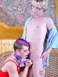 Funky sissy with crazy hair seduces a geeky boy into male-on-male action pictures