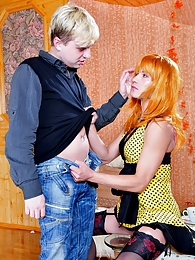 Fiery crossdresser in a sexy gown and undies invites his mate for butt play pictures