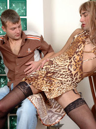 Sissy in a leopard print dress lets his animal instincts go wild in gay sex pictures