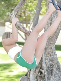 Stephanie climbs a tree in the park pictures at lingerie-mania.com
