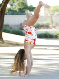 Tara does a flip in the park pictures at find-best-babes.com