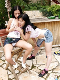 Two cute girls experimenting with their vibrator in the yard pics
