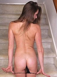 Candice Ferguson spreads shaved pussy on the stairs pictures at freekilomovies.com