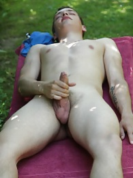 Tattooed Peter Jules masturbating outside in the yard pictures at sgirls.net