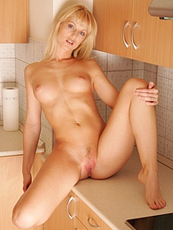 She spreads her sweet pussy on the kitchen counter pictures at lingerie-mania.com