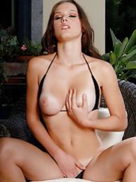 Showing off her sweet breasts for you pictures at freekilosex.com