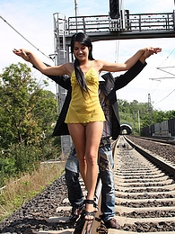 A teenage chick loves daring anal shagging on a railway pictures at kilogirls.com