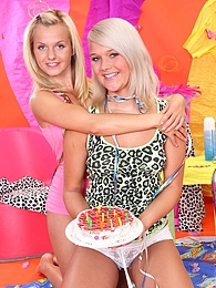 Two cute teenage lesbians playing with a pie and their pussy pictures at relaxxx.net