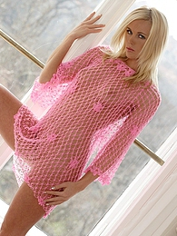 Sexy blonde shows off in front of the window pictures at adspics.com