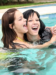 Two very hot teenage girls frolicking in the swimmingpool pictures at freelingerie.us