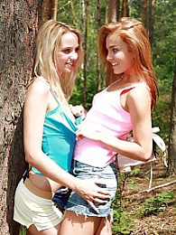 Two lesbian girls toying their tight wet pussy in a forest pictures