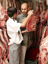 Teenage brunette gets dirty with the butcher his big meat pictures at freekiloporn.com