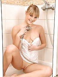 Sweet blonde girl takes a shower with her vibrating dildo pictures at freekilosex.com