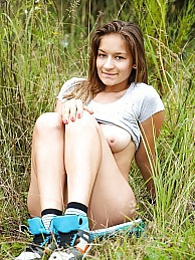 She thinks nobody can see her masturbating in the field pictures at adspics.com