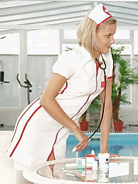 Naughty blonde teenage nurse inspecting a teenage pussy pictures at adspics.com
