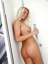 Favourite girl Jessy is playing with herself in the shower pictures at kilosex.com