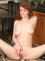 Perky redhead coed Abbey Rain plays with her pussy pictures