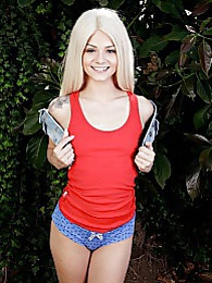 Pocket rocket Elsa Jean spreads tiny twat in the backyard pictures at kilosex.com