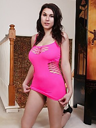 Busty Ella Jones strips out of her pink dress pictures at freekilopics.com
